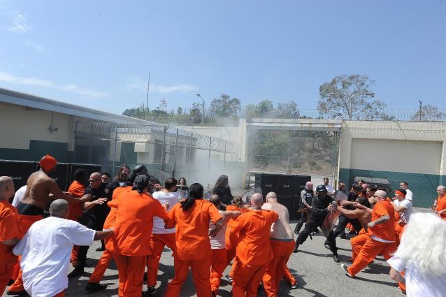 "Slayer shoots its music video for the new track ""Repentless.""  Shot on August 26, 2015 at the Sybil Brand Institute in Los Angeles. Prisoners start to riot as Slayer performs. BAND L-R:  Gary Holt, drummer Paul Bostaph, Tom Araya, Kerry King"